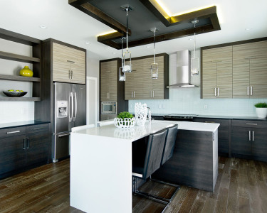 Ultra contemporary open concept kitchen with two-toned cabinets, available at Superior Cabinets.