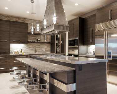 Contemporary kitchen with an industrial feel, custom canopy food fan, floating shelves, built-in appliances, large island, stainless steel countertops, quartz countertops, Glideware in pantry with glass doors, available at Superior Cabinets.