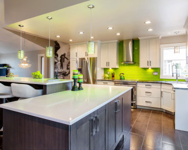 Funky open concept two-toned kitchen with light and dark cupboards/cabinets and a vibrant lime green tiled backsplash. This is a full kitchen renovation form our VEGA series. Available at Superior Cabinets. Fusion Cabinets, Fusion finishes, Fusion cupboards.