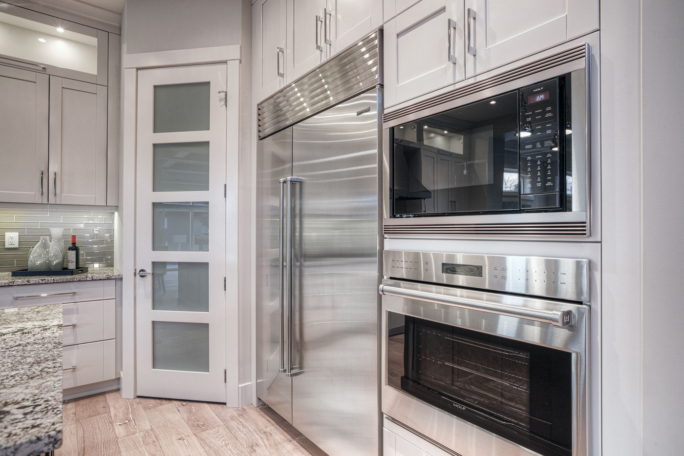 Beautiful Contemporary Two Toned Kitchen With Painted White Maple Cabinets On The  Perimeter And Medium Stained