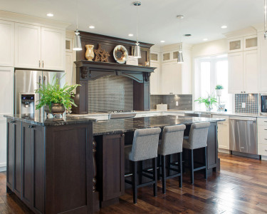 Traditional style kitchen featuring with two-toned painted white maple cabinets and a rich dark stain on Hickory Wood and a custom wood hood/mantle, available at Superior Cabinets.