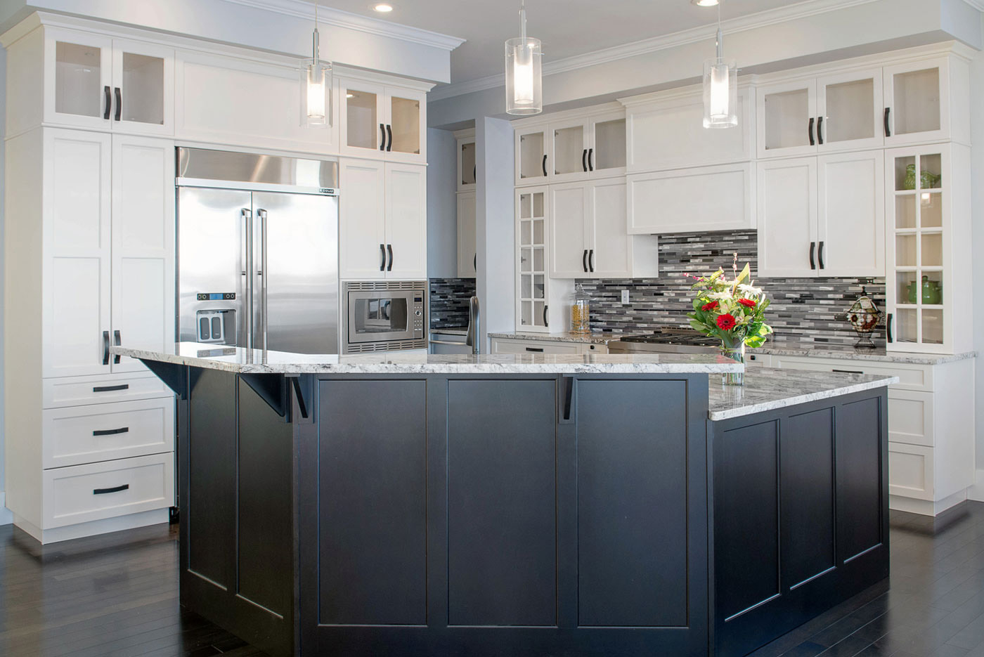 Beautiful contemporary kitchen. Two-toned cabinetry with white painted maple cabinets on the perimeter and dark stained maple cabinets on the island, available at Superior Cabinets.
