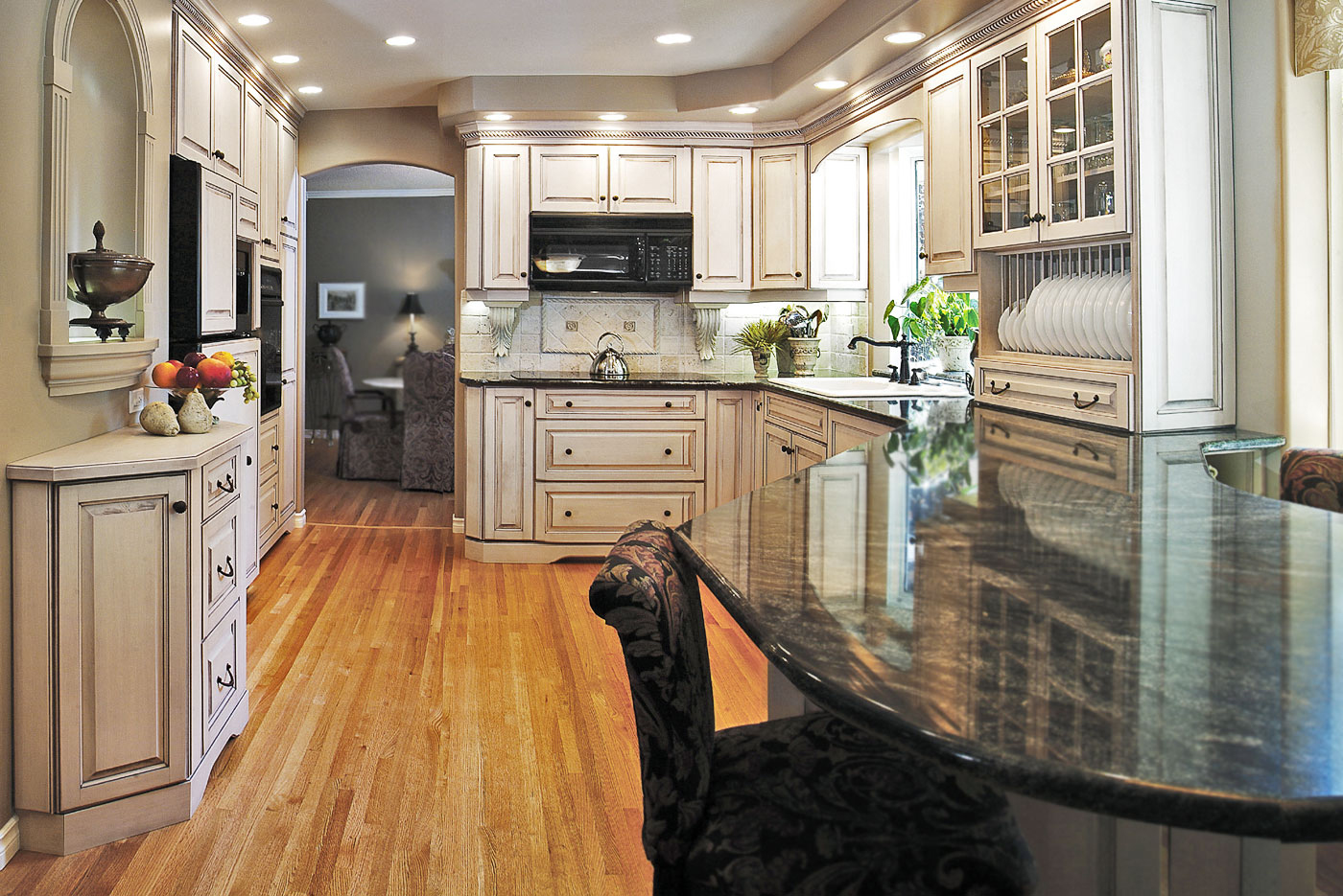 Old World kitchen in a light chalked handcrafted finish on maple, large peninsula, granite countertops, this kitchen was a winner of a CHBA National SAM award, available at Superior Cabinets Saskatoon, Regina, Calgary, Edmonton.