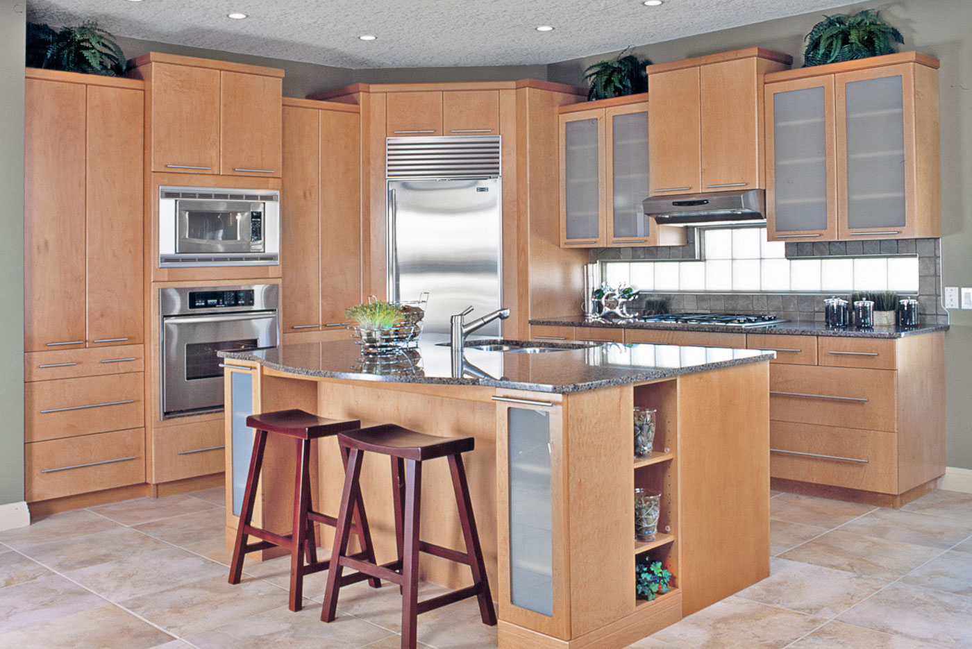 Contemporary kitchen with medium stained cabinets cupboards, stainless steel appliances, large island, granite countertops, available at Superior Cabinets Saskatoon, Regina, Calgary, Edmonton.