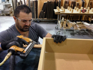 Superior Cabinets employee constructing a doll house for Parkland County Fire Department training.