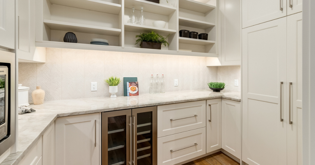A butler's pantry with painted white MDF uppers and lower cabinets, design and cabinets by Superior Cabinets Canada and USA.
